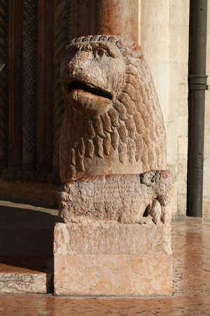 Modena, ancient statue of lion, cathedral architectural details, romanesque style, Italy