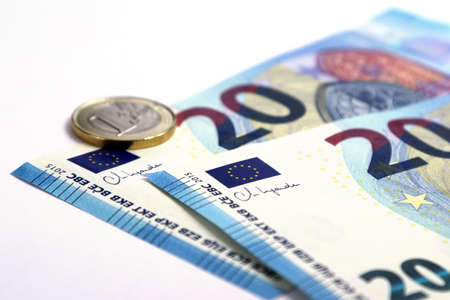 20 Euro currency banknote with Christine Lagarde signature and one Euro coins, European Union