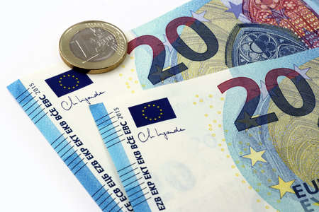 20 Euro currency banknote with Christine Lagarde signature and one Euro coins, European Union Archivio Fotografico - 160977769
