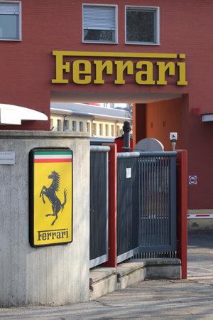 Maranello, Modena, Italy, February 2021 - Entrance of the original Ferrari Automobiles factory with the Ferrari logo in the foreground Editoriali