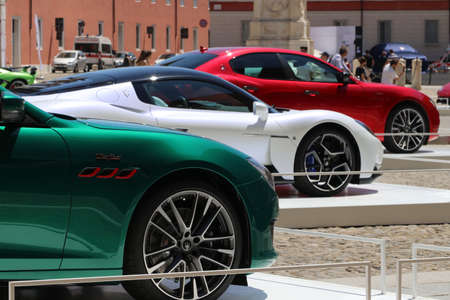 MODENA, ITALY, July 1 2021 - Motor Valley Fest exhibition, Maserati cars parade in the square
