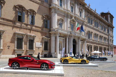 MODENA, ITALY, July 1 2021 - Motor Valley Fest exhibition, Ferarri cars parade in front of the Ducal Palace