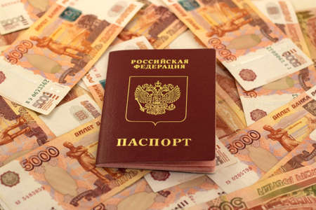 thousandth: Russian foreign passport in the background of five thousandth bills