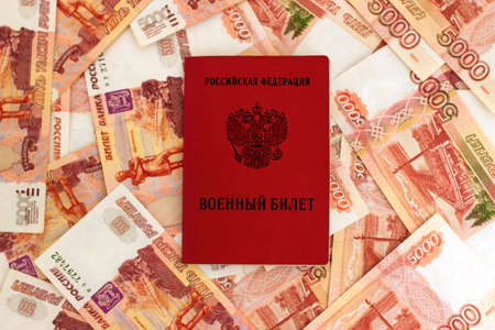thousandth: Russian military card on the background of five thousandth banknotes