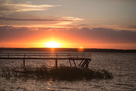 Wooden pier at sunset photo