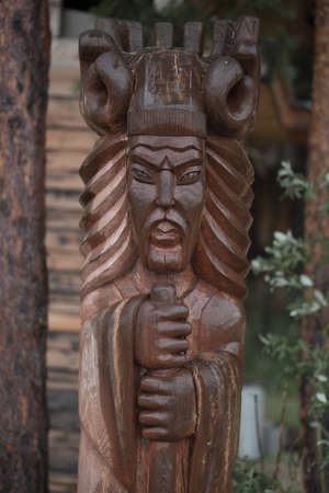 Wooden figure in the forest