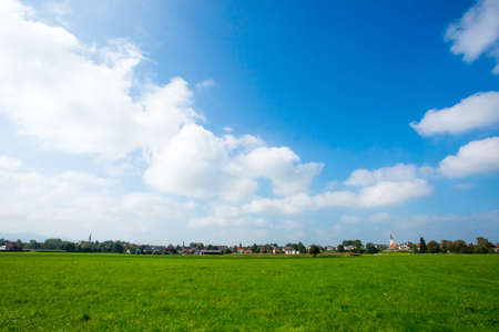 green meadows: Bright green meadows and blue sky photo for you