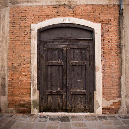 wood door: The door to the building. Venice. Photo for you Stock Photo