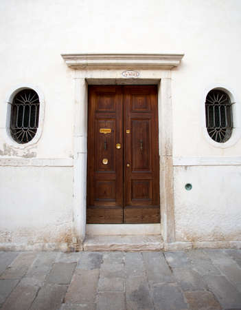 view of a wooden doorway: The door to the building. Venice. Photo for you Stock Photo