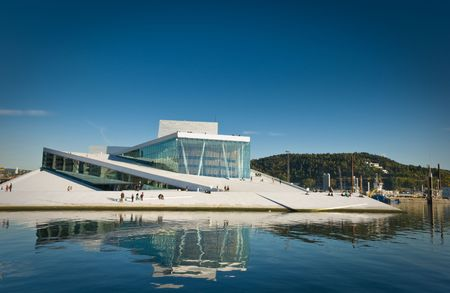 The new operahouse in Oslo, Norway. Building was finished 2008. The exteriors are built of marble and glass, and the roofs and exteriors are open for the public. The picture is a merge of 10 pictures using PhotoAcute to get more details.