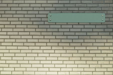 regular: An empty sign on a new brick wall.  Fill in some text in the sign yourself.