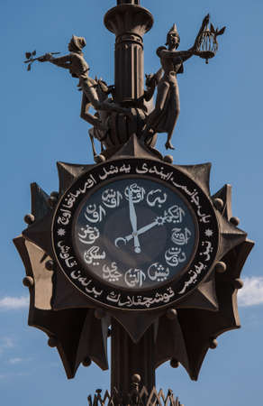 Bronze monumental-decorative composition with the clock set at the beginning of Bauman street in Kazan. Present the figure of the poet, Pegasus and the muses. Russia 免版税图像