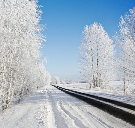 rut: Winter road on a sunny frosty day Stock Photo