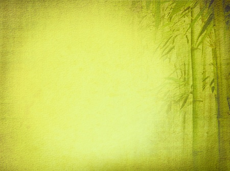 Old textured paper background with green bamboo  Asian design for zen culture tradition  photo