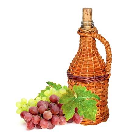 Hungarian bottle of wine in a wicker case of the vine  Old traditional vintage wine bottle and red grape  Banco de Imagens