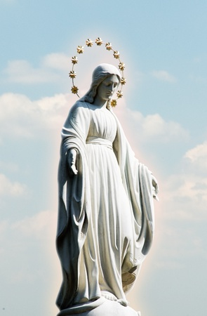 Virgin Mary at the sky background  Holy phenomenon of the Holy Maria in the halo of glow in the sky above the clouds