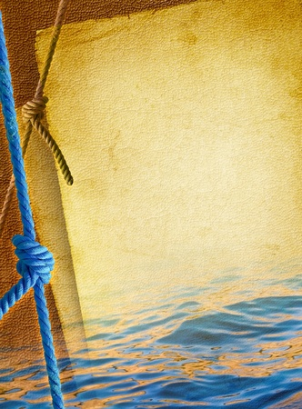 Marine rope for mooring yachts, tied by knot against the old textured paper background  Blue rope line with knot of the sea - vintage nautical background  Marine design with elements of boating  Banco de Imagens