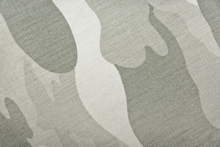 Camouflage background  Textil pattern with camouflage texture - fragment of the military cloth  Material for the soldier wear  Stock Photo