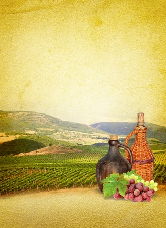 Still life with wine, grapes and vineyard  Wine list menu - vintage composition with wine on the old textured paper