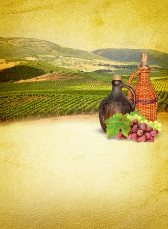 Wine still life - retro composition with a vineyard  Wine list menu with vineyard, jugs and grapes  Wine lifestyles - vintage paper background  photo