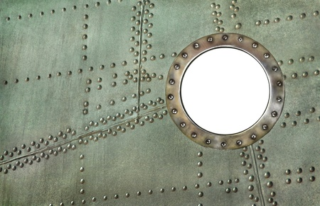 Porthole frame at the old aircraft  Porthole - white hole window isolated at the metal background with rivets
