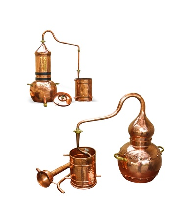 Alembic Copper - Distillation apparatus employed for the distillation of alcohol, essential oils and moonshine  Modern wine distillery for the home made of the wine isolated on white