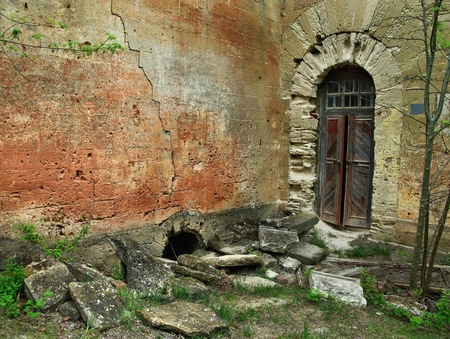 Old building, the entrance to an abandoned house, the old walls and the front door  photo