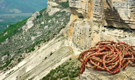 recreational climbing: Alpine equipment - mountain climber ropes on the high rock  Stock Photo