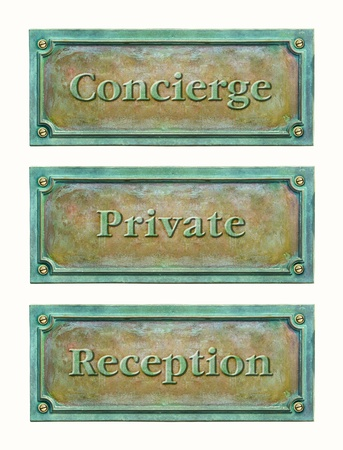 Bronze sign plaque for the hotel or home  concierge, reception, private  Brass plaque with text for the doorplate  Metal grunge nameplate with names for interior or exterior design Stock Photo