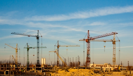 construction project: Building site and cranes - construction  landscape