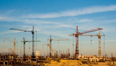 Local de construção e guindastes - construção da paisagem Banco de Imagens