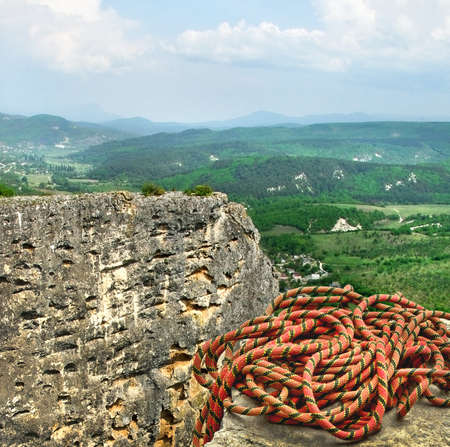 Climbing rope on the peak of the mount  Mountain landscape with alpine rope  photo