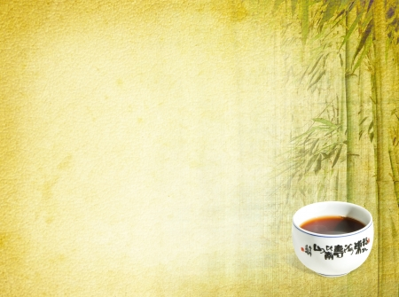 Chinese background with a cup of tea, text and bamboo photo