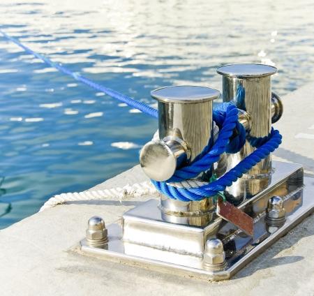 mooring: Mooring ropes on a bollard of sea harbor