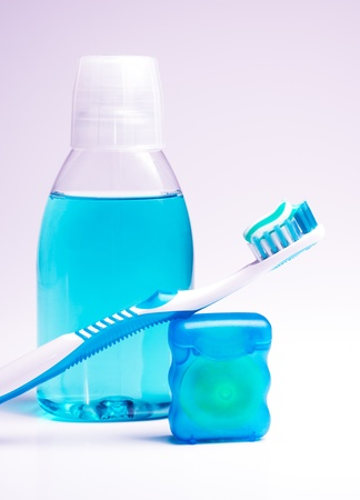 floss: Dental hygiene - mouthwash, toothbrush and tooth floss Stock Photo