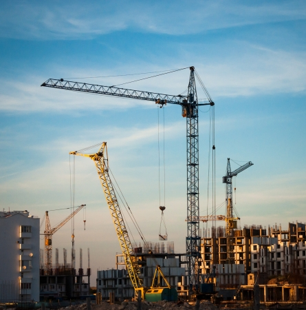 Construction site with building cranes - industrial landscape  Stock Photo