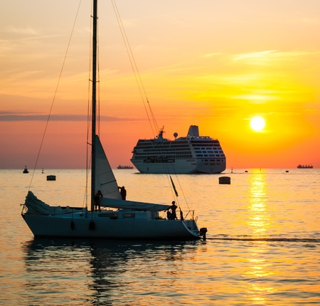 Yacht and cruise ship on sea sunset photo