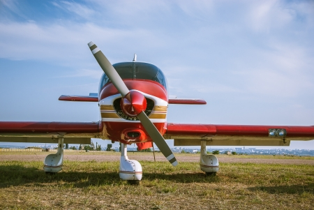 Red plane - propeller, wings and fuselage of the aircraft photo