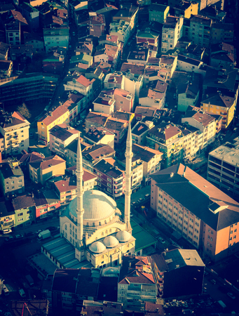 minarets: Mosque with minarets on Istanbul cityscape. Stock Photo