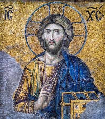 ISTANBUL, TURKEY - APRIL 17, 2015: Jesus Christ at golden backdrop in the Hagia Sophia temple in Istanbul. Ancient byzantine mosaic of the image of Jesus Pantocrator with a blessing hand and Gospel.