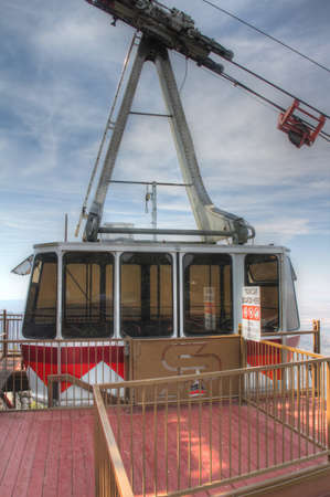 resides: Sandia Peak Tramway gondola transports visitors from the crest of Albuquerque, New Mexico, to the edge of the Sandia mountains  Here the gondola resides in the summit station Stock Photo