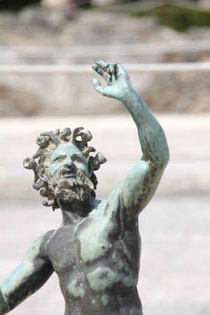 faun: Statue of the dancing Faun in the House of Faun in the archological site of Pompeii in Italy