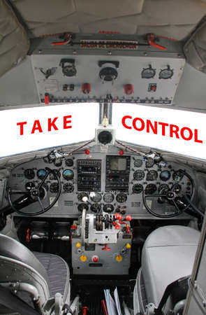 Cockpit interior of operational DC3 airplane vertical view photo