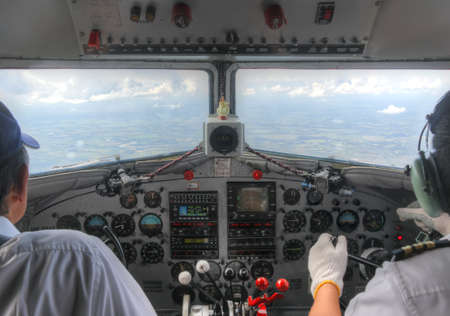 Cockpit view of DC3 in flight with pilots photo