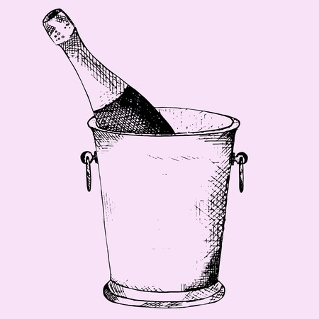Champagne bottle in a ice bucket on pink background