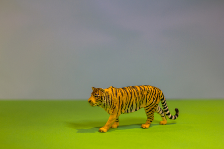 Like a real tiger. Toy tiger on a bright studio background. Eco toys. Stock Photo