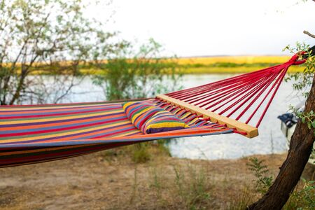 Hammock on the background of the river. Camping in the wild. A weekend away from civilization. Tourism in Kazakhstan.
