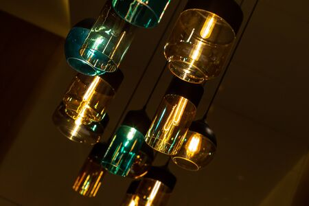 Modern indoor lighting. Beautiful colored glass shades. Pleasant warm and cold tones.