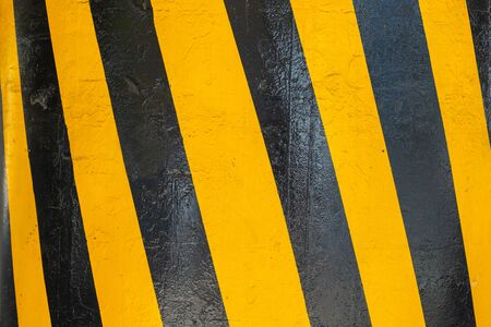 Yellow and black stripes diagonally. Warning lines in black and yellow. Striped rectangle. Warning to be careful - the potential danger