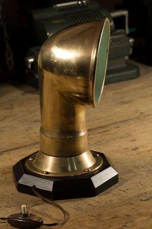 lámpara de bronce pieza con la nave Foto de archivo